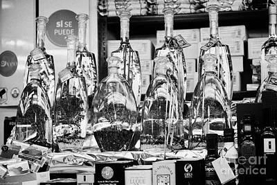 infused olive oils inside the la boqueria market in Barcelona Catalonia Spain Art Print by Joe Fox