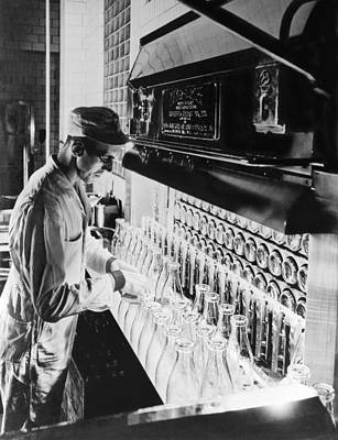 Factory Photograph - Inspecting Milk Bottles by Underwood Archives