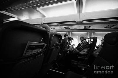 Passenger Plane Photograph - Interior Of Jet2 Aircraft Passenger Cabin In Flight Europe by Joe Fox