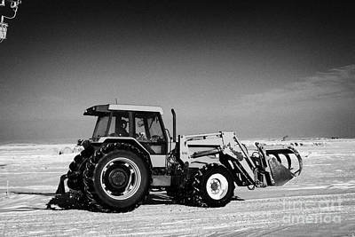 Harsh Conditions Photograph - international 5140 tractor with front end loader on frozen field Forget Saskatchewan Canada by Joe Fox