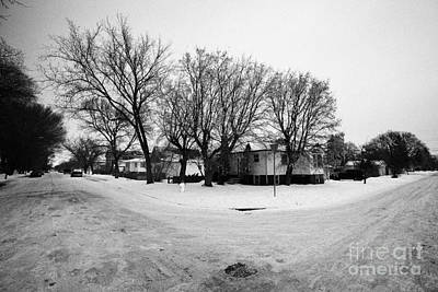 intersection of snow covered residential streets Saskatoon pleasant hill Saskatchewan Canada Art Print