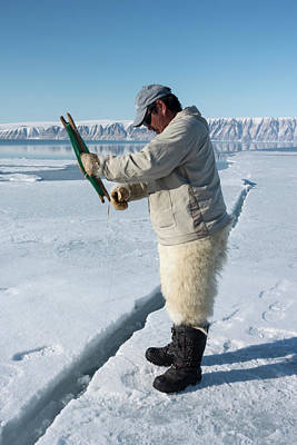 Ice Fishing Photograph - Inuit Hunter Line Fishing by Louise Murray