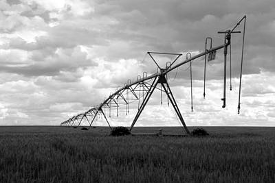 Photograph - Irrigator by Daniel Woodrum