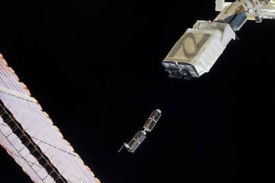 Iss Deploying Satellites Art Print by Nasa
