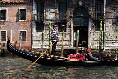 Italy, Venice A Gondolier Strikes Art Print by Jaynes Gallery