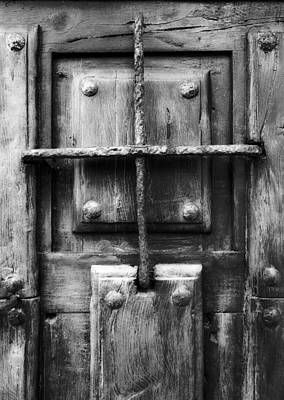 Photograph - Vintage Solid Wood Door With Metal Nails And Metal Grille - Jail Of My Life Bw Version by Pedro Cardona