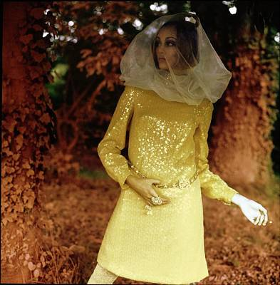 Adele Wall Art - Photograph - Jane Hitchcock Wearing A Yellow Dress by Arnaud de Rosnay