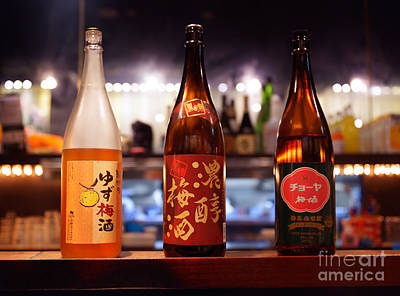 Sake Bottle Photograph - Japanese Sake Bottles In A Bar by Oleksiy Maksymenko