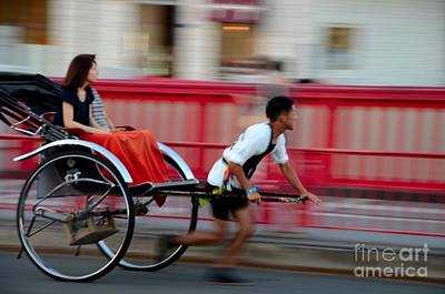 Photograph - Japanese Tourists Ride Rickshaw In Tokyo Japan by Imran Ahmed