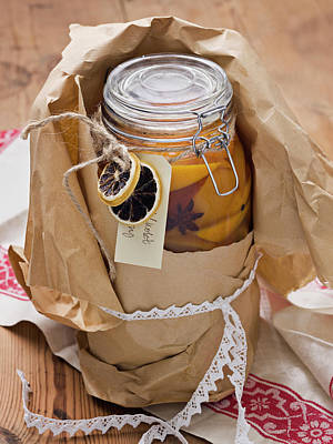 Jar Photograph - Jar With Preserved Orange Slices by Johner Images