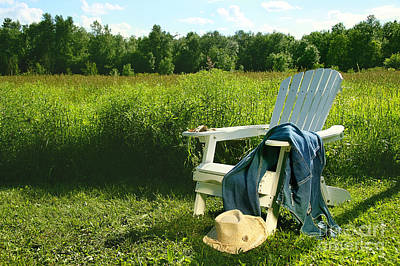 Photograph - Jeans Laying On Adirondack Chair In Field by Sandra Cunningham