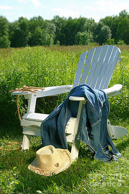 Photograph - Jeans Laying On Chair  by Sandra Cunningham