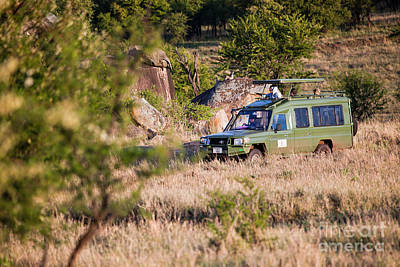 Africa Photograph - Jeep With Tourists On Safari In Serengeti. Tanzania. Africa. by Michal Bednarek