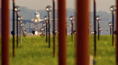 On The Runway Photograph - Jet Airplane Taking Off From Detroit by Panoramic Images