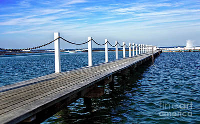 Jetty Stretching To The Ocean Art Print by Kaye Menner