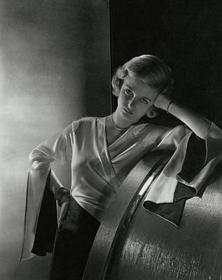 Film Industry Photograph - Joan Bennett Leaning On A Barrel by Cecil Beaton