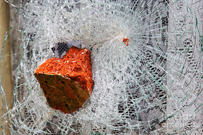 Vandalize Photograph - Joe Fox Fine Art - Brick Stuck In Smashed Window by Joe Fox