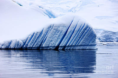 Fournier Photograph - Joe Fox Fine Art - Snow Covered Iceberg Showing Blue Ice Lines Created By Bubbles And Fresh Water Floating In The Sea by Joe Fox