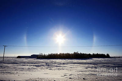 Joe Fox Fine Art - Sun Dog Parhelion Halo Due To Ice Crystals Surrounding The Sun Art Print by Joe Fox