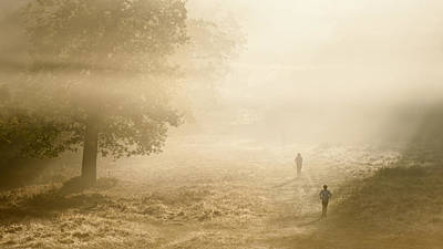 Joggers In Richmond Park London On A Crisp Foggy Autumn Morning Art Print by Matthew Gibson