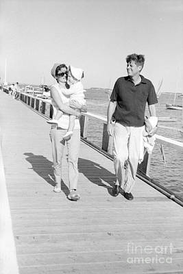 John F. Kennedy And Jacqueline Kennedy At Hyannis Port Marina Art Print by The Harrington Collection