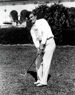 Full-length Portrait Photograph - Johnny Revolta Playing Golf by  Acme