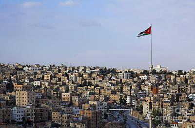 Jordanian Flag Flying Over The City Of Amman Jordan Art Print by Robert Preston