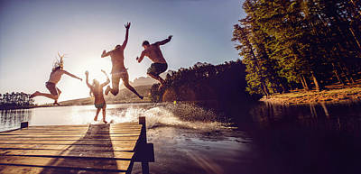 Jumping Into The Water From A Jetty Art Print by Wundervisuals