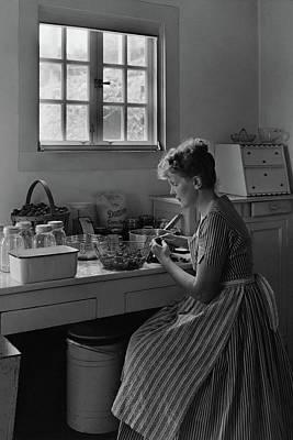 Photograph - June Plat Preparing Food In Her Kitchen by Samuel H. Gottscho