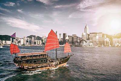 Photograph - Junk Boat In Victoria Harbour by Yongyuan Dai