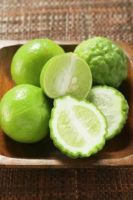 Kaffir Limes And Limes In Wooden Bowl Art Print