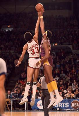 Nba Photograph - Kareem Abdul Jabbar Vs. Wilt Chamberlain Jump Ball by Retro Images Archive