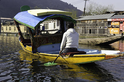 Kashmiri Man Driving This Shikara In The Still Waters Of The Dal Lake Art Print by Ashish Agarwal
