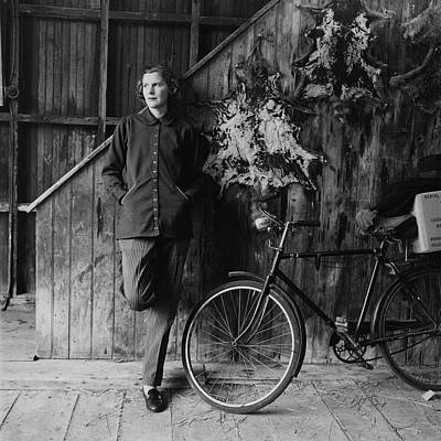 1950s Fashion Photograph - Katharine Shields By A Bicycle by Richard Rutledge