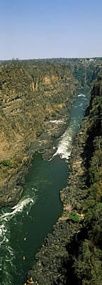 Kayakers Paddle Down The Zambezi Gorge Art Print