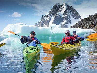 Canoe Photograph - Kayaking Off Petermann Island by Peter Menzel