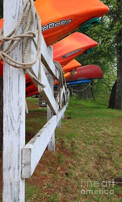 Kayaks On A Fence Art Print