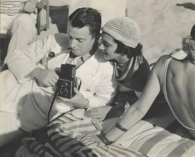 Kenneth Mackenna And Kay Francis With A Camera Art Print