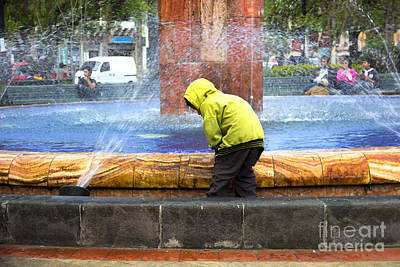 Raincoat Photograph - Kids And Water Do Mix by Al Bourassa