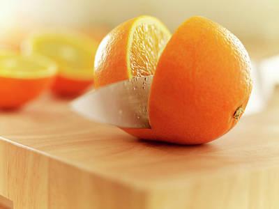Food Photograph - Knife Slicing Orange On Cutting Board by Adam Gault