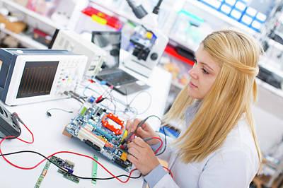 Circuit Photograph - Lab Assistant Using A Circuit Board by Wladimir Bulgar