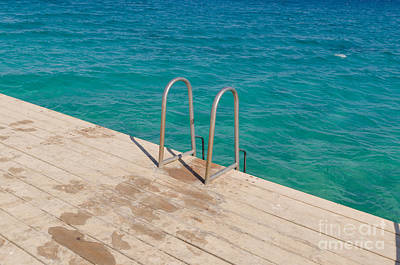 Swim Ladder Photograph - Ladder On A Wooden Bridge by Nikita Buida