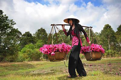 Lady Caries Lotus Flowers Art Print