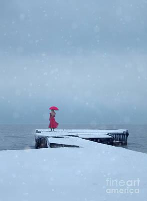 Lady In Red On Snowy Pier Art Print by Jill Battaglia