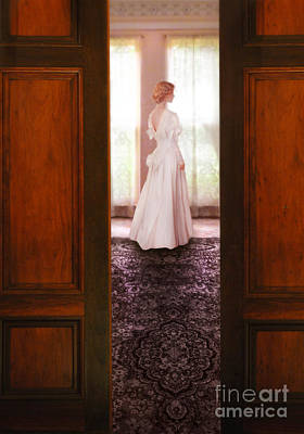 Bridal Gown Photograph - Lady In White Gown Seen Through Doors by Jill Battaglia