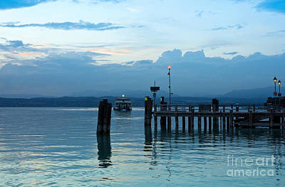 Lake Garda Pier And The Last Ferry For The Day Art Print by Kiril Stanchev