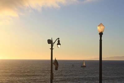 Photograph - Lamp Flag Sunset by Daniel Schubarth