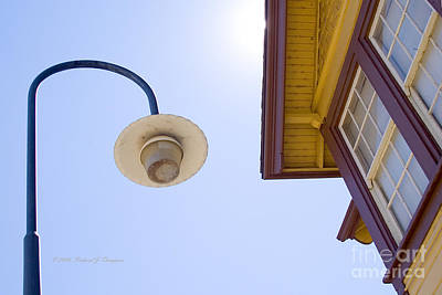 Photograph - Lamppost And Building by Richard J Thompson