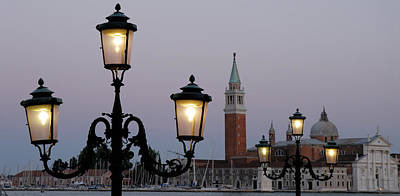 Domes Of Venice Photograph - Lampposts Lit Up At Dusk With Building by Panoramic Images