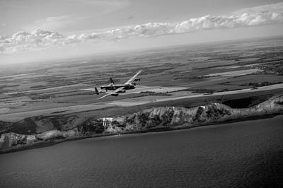 Photograph - Lancaster Over The White Cliffs In Kent Black And White Version by Gary Eason